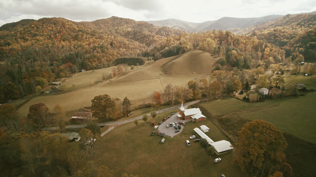 Scenic aerial video with the autumn's scenic view on the small country church in the valley between mountains in Tennessee, USA. video
