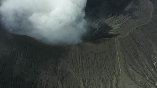 Scenic aerial view of Bromo volcano erupting