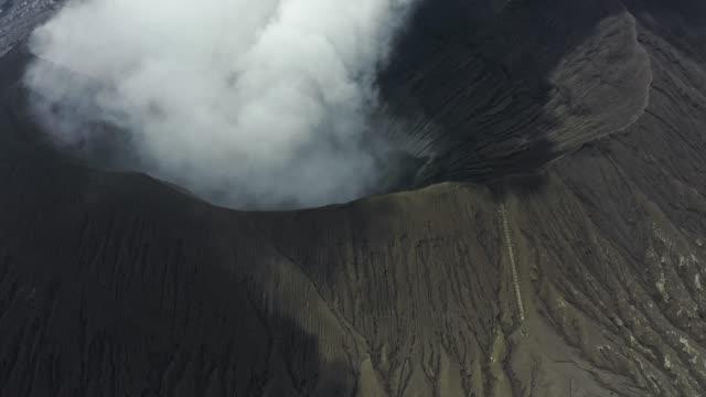 Scenic aerial view of Bromo volcano erupting
