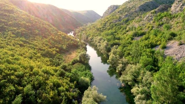 scenic aerial view of cetina river, blato na cetini, croatia. - group of people filmów i materiałów b-roll