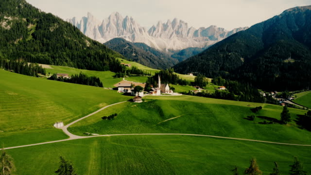 Scenic aerial  view of church  in Dolomites Alps