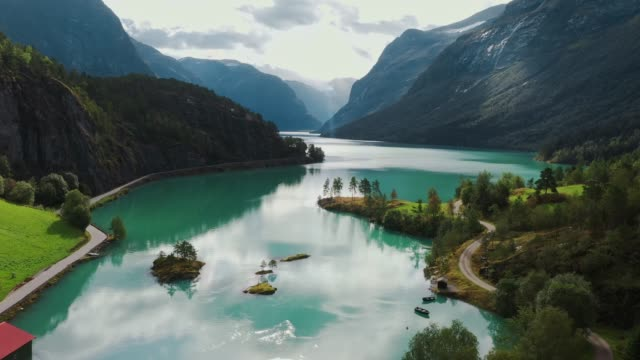 Scenic aerial view of glacier river in Norway Scenic aerial view of glacier river  in Norway in summer, Lovatnet european alps stock videos & royalty-free footage
