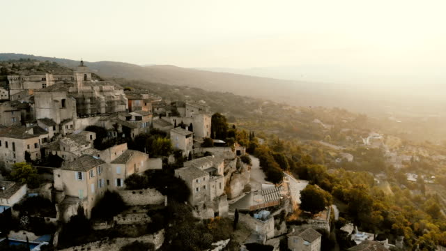 Scenic aerial  view of Gordes village in Provence Scenic aerial view of Gordes village in Provence, France provence alpes cote d'azur stock videos & royalty-free footage
