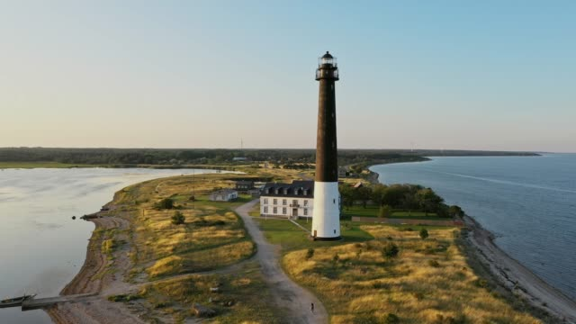 Scenic aerial view of lighthouse at sunset