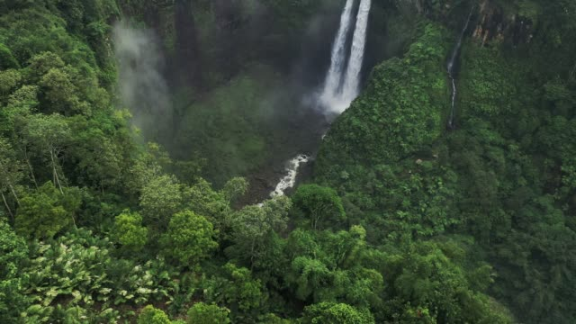 Scenic aerial view of Madakaripura waterfall on Java