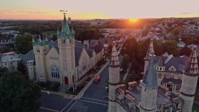 Scenic aerial view of Nazareth, Pennsylvania, with his churches at sunset. Aerial drone video with the forward camera motion.
