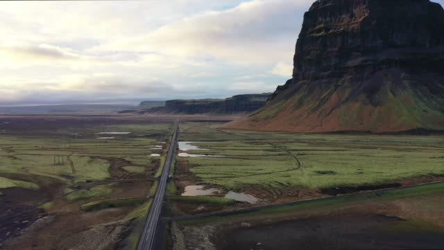 Scenic aerial view of road near the river in Iceland video