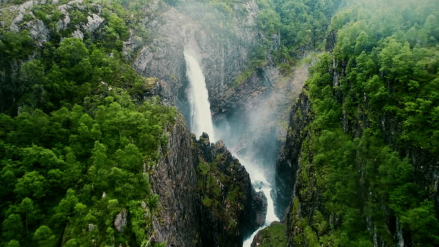 scenic aerial view of voringfossen waterfall and river - aerial mountain stock videos & royalty-free footage