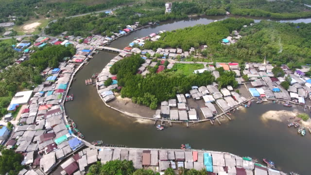 scenic coastal village with curved river and sea background, aerial video - графство дерри стоковые видео и кадры b-roll