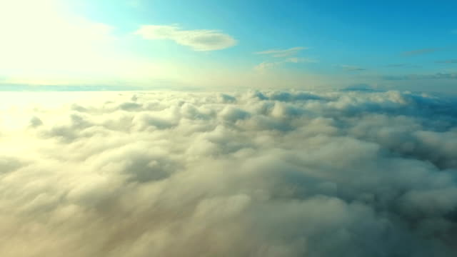 Scenic flight above the clouds towards the sun video