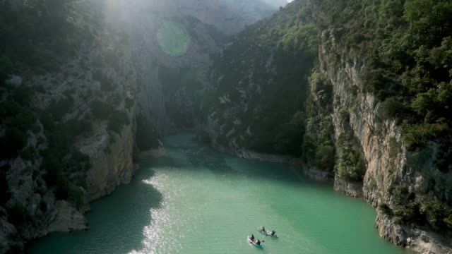 Scenic high angle view of  people kayaking in Verdon gorge in Provence Scenic high angle view of  people kayaking in Verdon gorge in Provence, France provence alpes cote d'azur stock videos & royalty-free footage