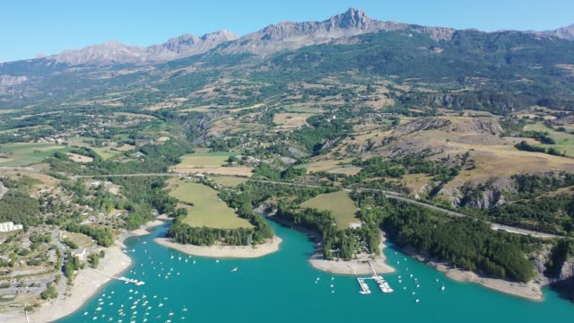 scenic mountain landscape of french alps with turquoise waterspace of artificial lake serre-poncon - barrage de serre poncon stock videos & royalty-free footage