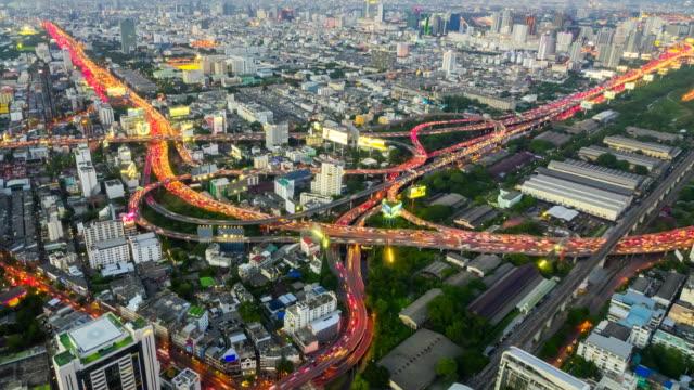 Scenic panoramic view of beautiful highway road traffic lights at night in Bangkok, Thailand. video