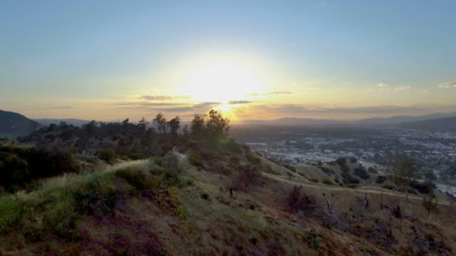Scenic shot over trees and trails in Los Angeles, Griffith Park sunset video