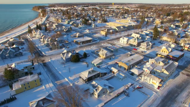 Scenic, sunrise aerial flyover of Small Town America with lake video