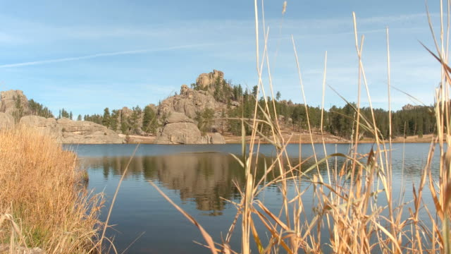 Scenic Sylvan Lake shoreline and rugged rocky outcrops covered with pine trees