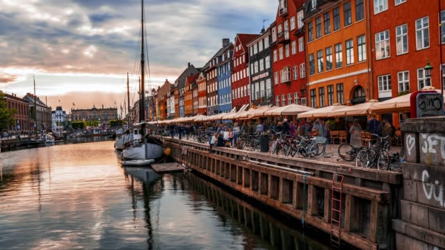 Scenic timelapse summer sunset view of Nyhavn, Copenhagen, Denmark Scenic timelapse summer sunset view of Nyhavn pier with color buildings, ships, yachts and other boats in the old town of Copenhagen, Denmark scandinavia stock videos & royalty-free footage