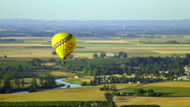Scenic video of single hot air balloon floating in the sky video