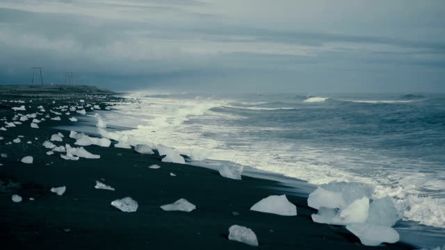 Scenic view of black sand beach near Jokulsarlon in Iceland video