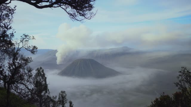 Scenic view of Bromo volcano at sunrise in fog