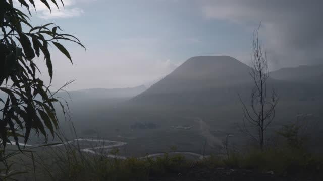 scenic view of bromo volcano at sunrise in fog - d'atmosfera video stock e b–roll