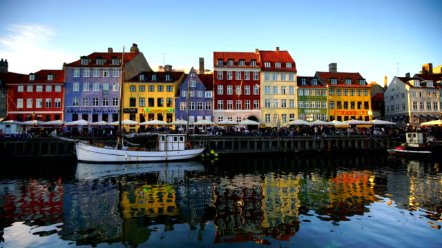 Scenic view of famous Nyhavn pier in the Old Town of Copenhagen Scenic view of famous Nyhavn pier in the Old Town of Copenhagen, Denmark denmark stock videos & royalty-free footage