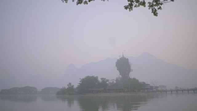 Scenic view of Kyauk Kalat Pagoda on lake in Hpa-An