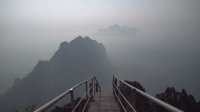 Scenic view of mountains in fog in  Hpa An from above