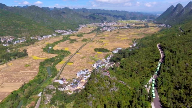 Scenic view of Rice Terrace and Traditional Chinese Village in Green Valley, Guizhou Province, China video