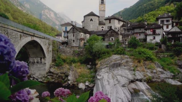 Scenic view of river and  Lavertezzo village
