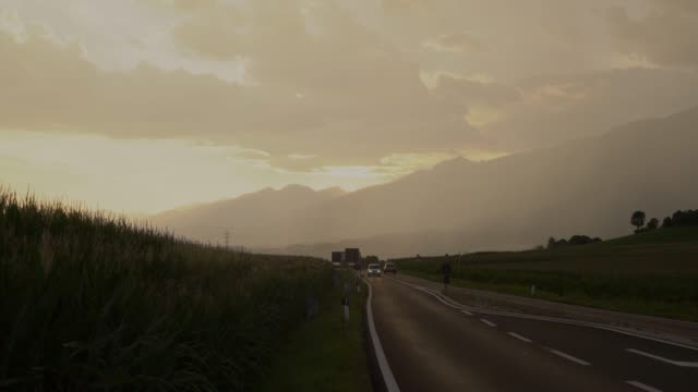 Scenic view of road in Switzerland after rain at sunset