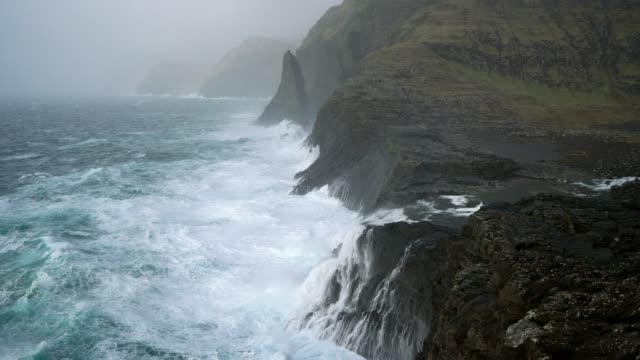 stockvideo's en b-roll-footage met schilderachtig uitzicht op zee in faeröer - rocks sea