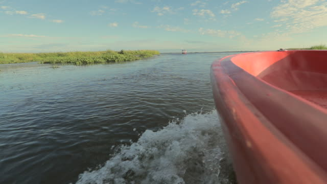 Scenic view of tour boat in morning at red lotus sea, Udon Thani in Thailand, slow motion