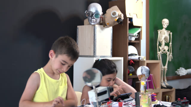 School Boy And School Girl Working On Coding And Robotics video