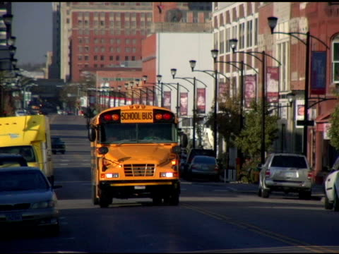 school bus small town traffic desmoines iowa 1 - school buses stock videos and b-roll footage