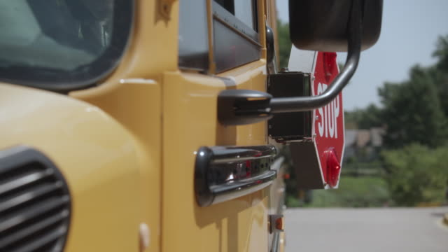 school bus stop sign opening - dolly 4 - school buses stock videos and b-roll footage