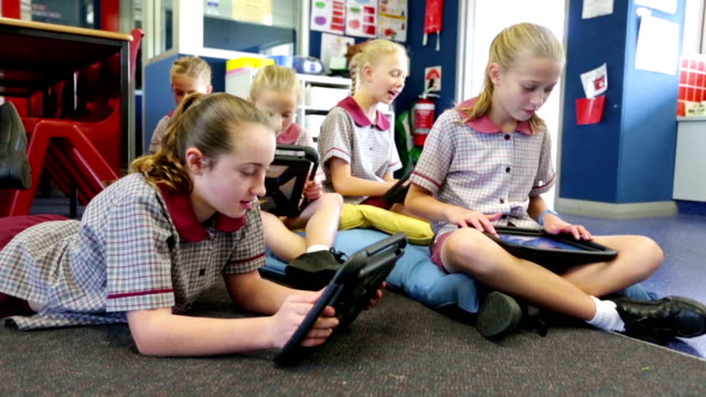School Children Using Tablet Computers in the Classroom video