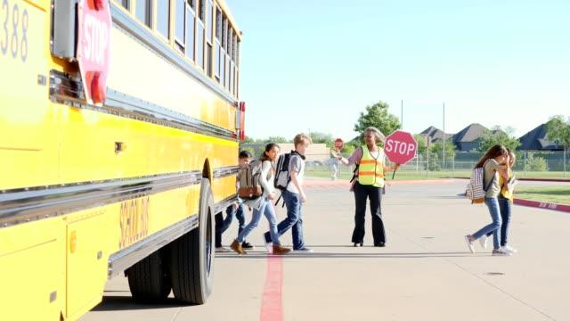 School crossing guard helps students cross street video