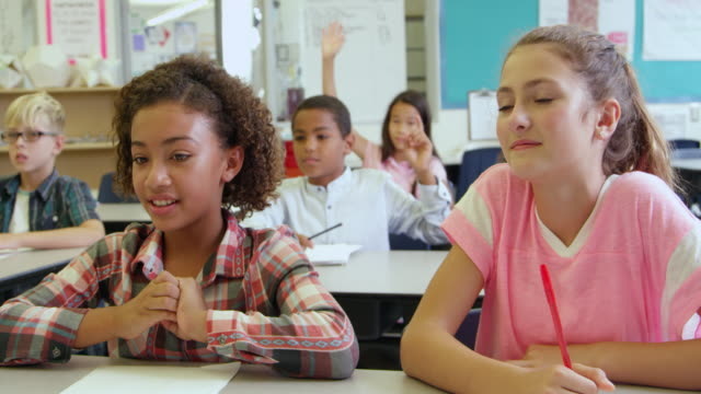 School kids answering questions in class, shot on R3D video