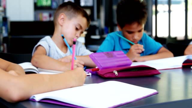 School kids doing homework in classroom video