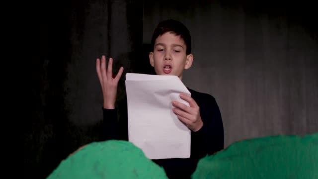 School Play Rehearsal 11 years old boy enjoying drama club rehearsal. Reading script. actor stock videos & royalty-free footage