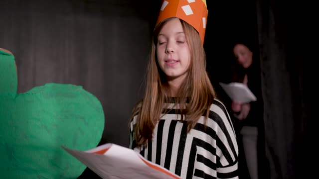 School Play Rehearsal 11 years old girl enjoying drama club rehearsal. Reading script. actor stock videos & royalty-free footage
