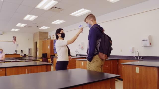 School Teacher Doing a Body Temperature Check