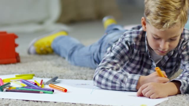 Schoolboy Drawing Picture on the Floor video