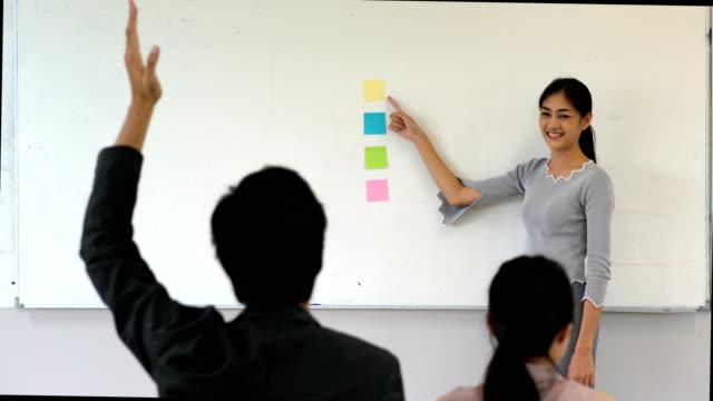Schoolgirl at front of class video