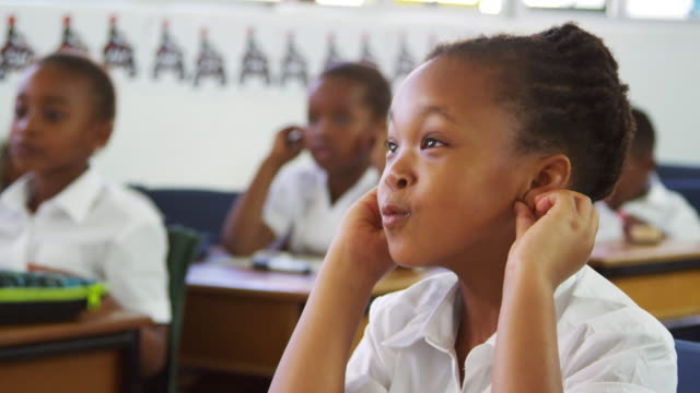 Schoolgirl listening during a lesson at an elementary school video