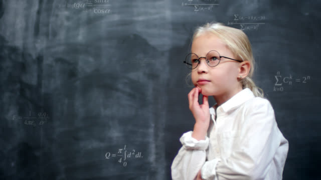 Schoolgirl Thinking Hard at Chalkboard with Animated Math Formulas Genius caucasian schoolgirl in eyeglasses and white shirt doing math in her head against blackboard with computer animated chalk drawings of equations and formulas genius stock videos & royalty-free footage