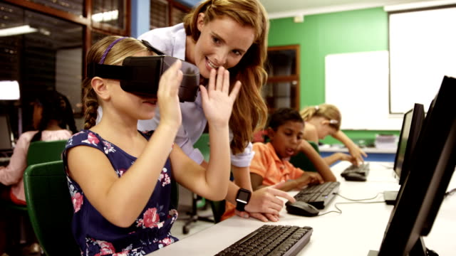 Schoolgirl using virtual reality glasses in classroom video