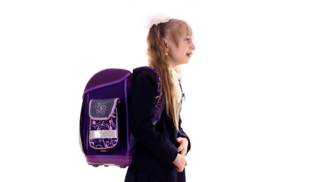 schoolgirl with a huge backpack is crying - nastro per capelli video stock e b–roll