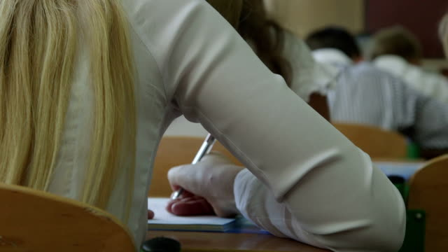 Schoolgirl writing in lesson time video